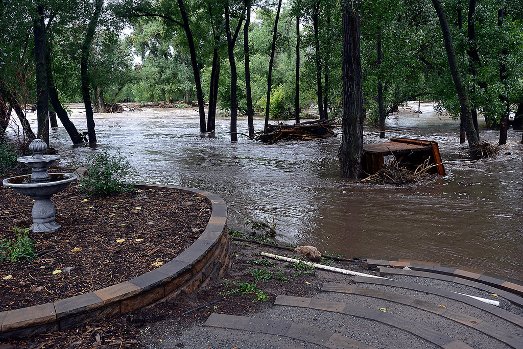 . A shed rests in the Big Thompson River as it floods a backyard on the 6700 block of Glade Road on Sunday, September 15, 2013 west of Loveland. (Photo by Jenny Sparks/Loveland Reporter-Herald)