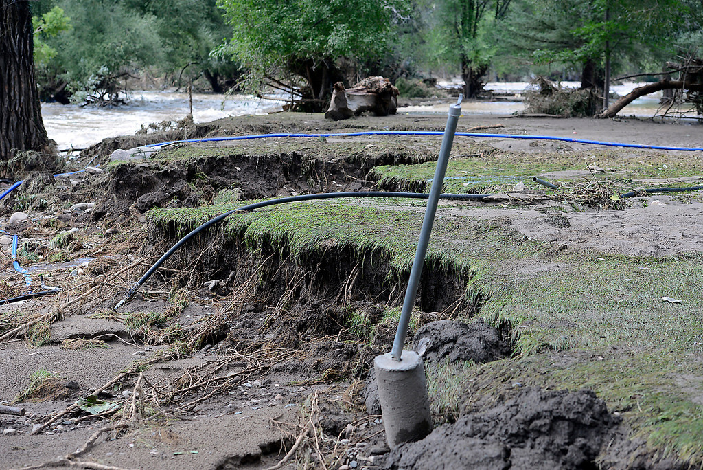 . Flood water washed away a huge chunk of Diana and Ken Carnahan\'s backyard seen here Monday, September 16, 2013 (Photo by Jenny Sparks/Loveland Reporter-Herald)