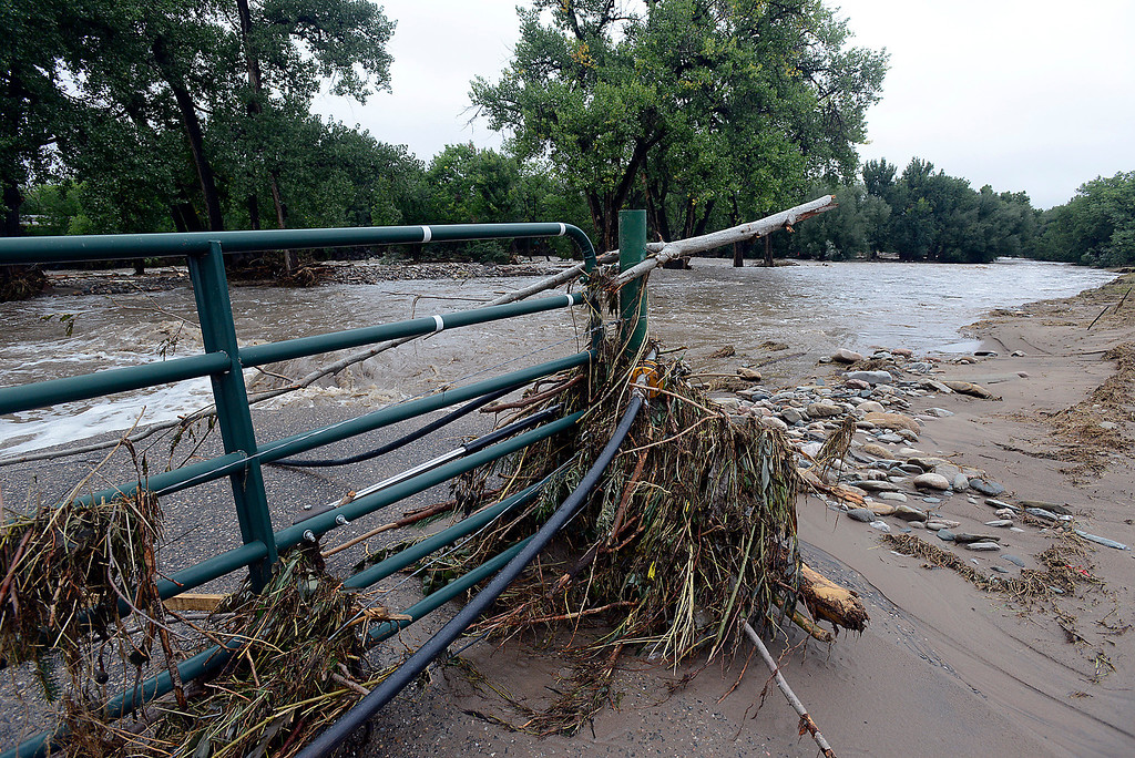 Description of . Flood debris collected all the way to the top of a gate into galde park is seen in west Loveland on Sunday, September 15, 2013 west of Loveland. (Photo by Jenny Sparks/Loveland Reporter-Herald)