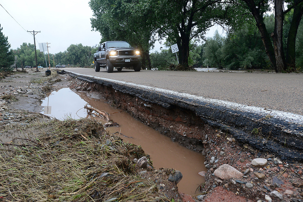 Description of . Part of Glade Road that was washed way by flood water is seen in west Loveland on Sunday, September 15, 2013. (Photo by Jenny Sparks/Loveland Reporter-Herald)