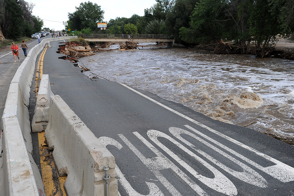 Description of . Baricades block of a section of U.S. 34 near the Riverview RV Park west of Loveland Tuesday, September 17, 2013, that was damaged when the Big Thompson River flooded. (Photo by Jenny Sparks/Loveland Reporter-Herald)