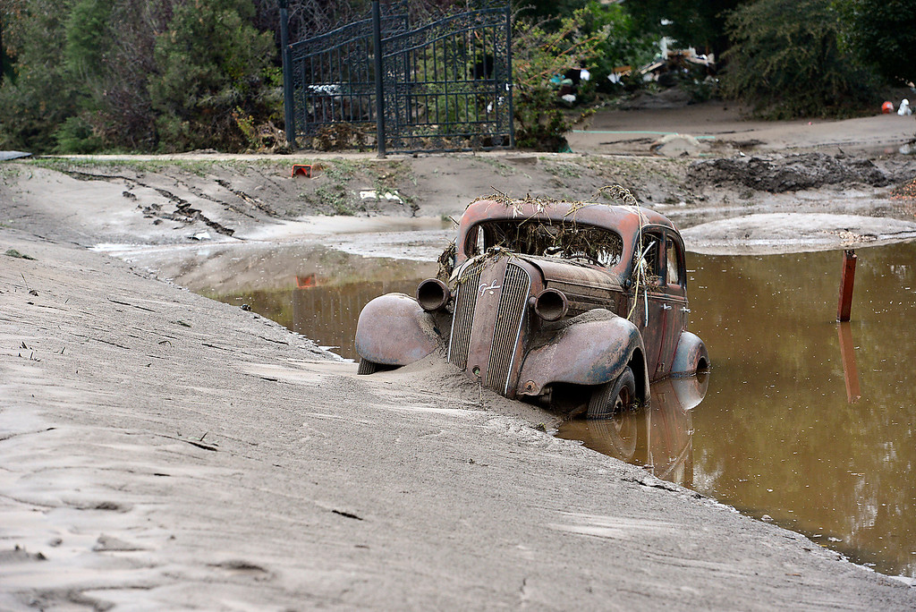 . An anitque car is buried in mud and flood water in west Loveland on Sunday, September 15, 2013 west of Loveland. (Photo by Jenny Sparks/Loveland Reporter-Herald)