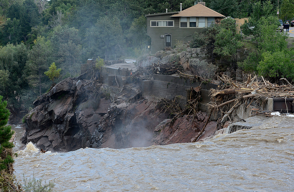 . Debris from the flood changes the scenery as the Big Thompson River rushes over the Nelson Dam near the Loveland Water Treatment Plant Tuesday, September 17, 2013, was washed away by the flood. (Photo by Jenny Sparks/Loveland Reporter-Herald)