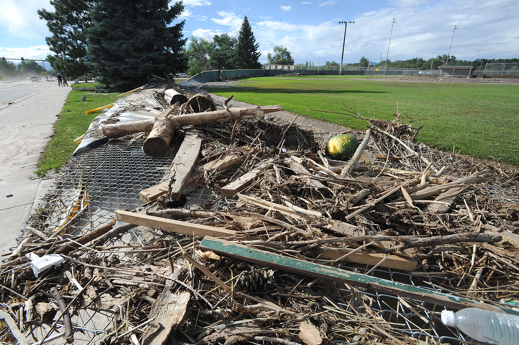 . A fence at one of the Centennial Park baseball fields lies flattened in the outfield Saturday, Sept. 14, 2014 after being destroyed by floating debris from recent flooding. (Photo by Steve Stoner/Loveland Reporter-Herald)