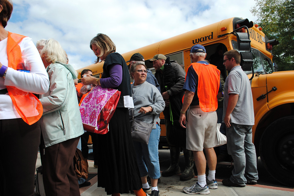 . Evacuees get off the first bus that arrived at Timberline Church in Fort Collins on Monday September 16, 2013. (Photo by Lilia Munoz/ Loveland Reporter-Herald)