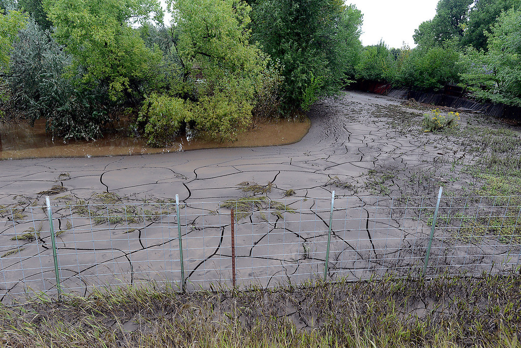 . Mud and silt from the Big Thompson River covers land on Glade Road on Sunday, September 15, 2013 west of Loveland. (Photo by Jenny Sparks/Loveland Reporter-Herald)